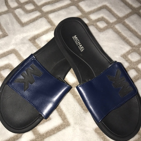 Michael Kors Shoes - Mk slides used condition but still good